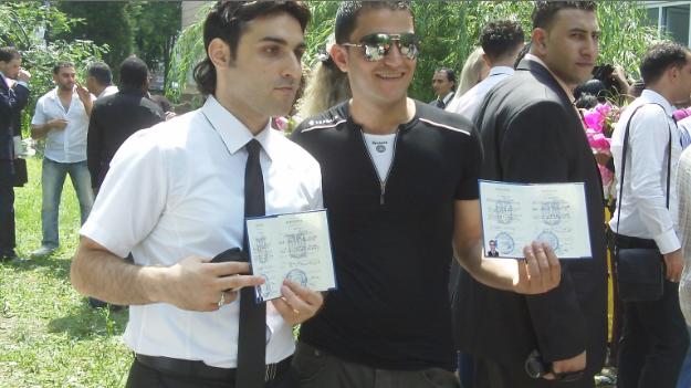 International Students Graduates Showing Their Diplom